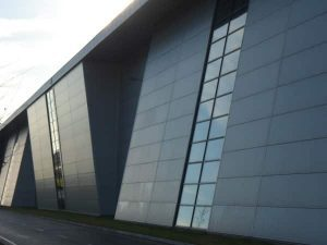 Powder coated insulated panels on a building
