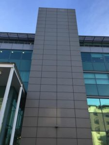 a commercial building finished with aluminium panels