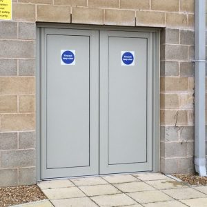 For secure doors such as these to a school, alumnium panels provide greater protection than obscure glass.